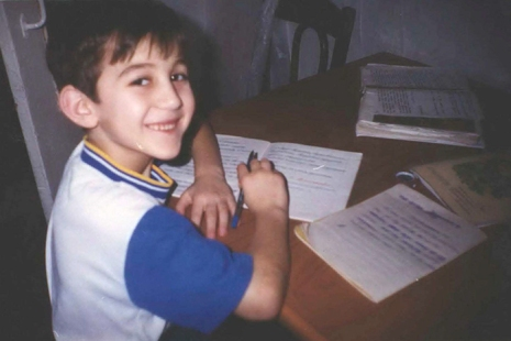 Dzhokhar as a child in Russia, doing his homework. This picture among many others were entered into evidence by the defense to try to show him as a studious, hardworking and obedient kid.